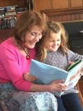 Corilee-reading-to-her-granddaughter_thumb.jpg